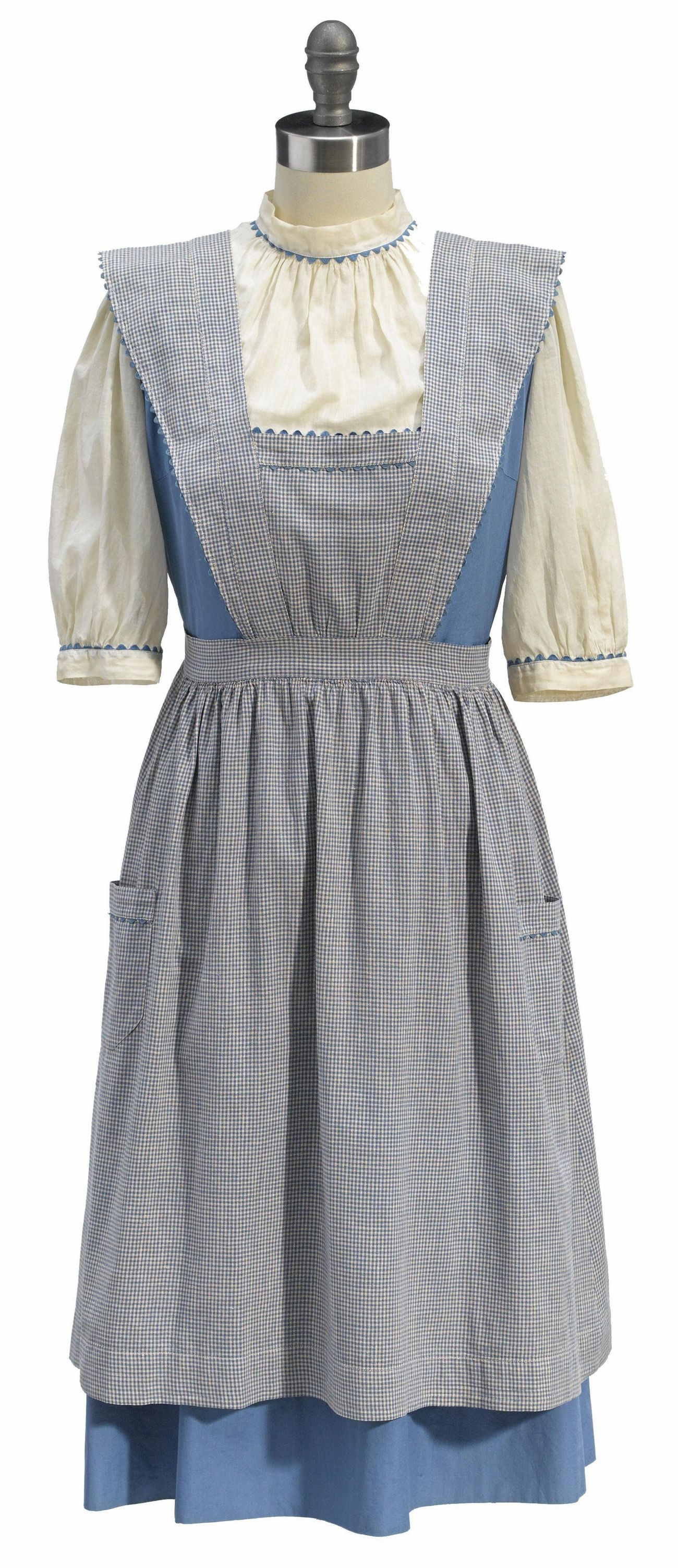 Lot 127 - A Dorothy test dress and pinafore from The Wizard of Oz - 1