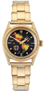 ROLEX, REFERENCE 6101 A Superlative and Possibly Unique 18k Gold and Cloisonné Automatic Wristwatch with Map of the Americas and Bracelet Estimate: $200,000 – $400,000