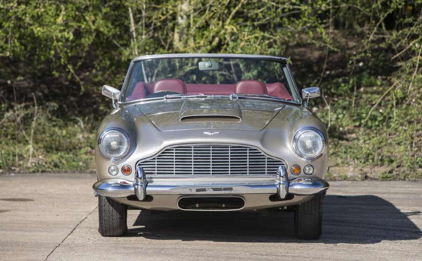 Sir Peter Ustinov in the 1962 DB4 Series IV Vantage Convertible sold for £1,524,700 at Bonhams Aston Martin WorksSale