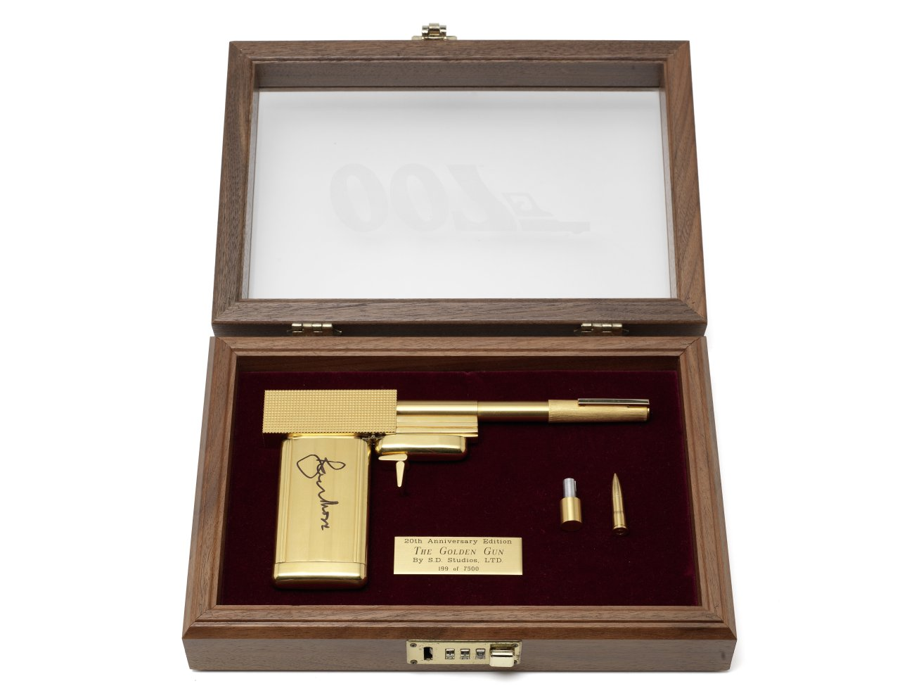 lot 116 - Signed by Sir Roger Moore, an SD Studios replica of the gun from The Man with the golden Gun,