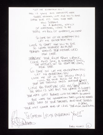 LOT 40- A SET OF HANDWRITTEN LYRICS FOR LET ME ENTERTAIN YOU
