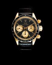 lot 194, Rolex. A fine 18K gold manual wind chronograph wristwatch Cosmograph,